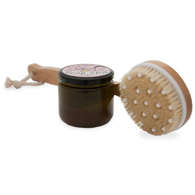 Sugar scrub pictured with dry skin brush